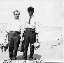 Image of N13014 - COUNT:2  REMARKS:Two men, each holding a very large crab caught in the Winchester Bay area. August 24, 1913. allard Walker on right.  OBJECT DATE:August 24, 1913