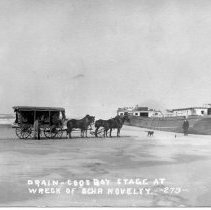 Image of N13051 - REMARKS:Drain-Coos Bay stage at the wreck of the NOVELTY. 4-horse stage. ca. 1910?  OBJECT DATE:ca. 1910?