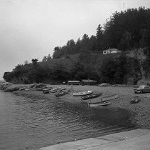 Image of N13302 - REMARKS:Small boats lined up on shore at Winchester Bay,  OBJECT DATE:July 17, 1953
