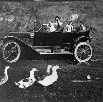"""Image of N13323 - REMARKS:Mrs. Erhart and three children in an automobile on September 13, 1913, Gardiner, OR. Postcard marked """"Going for a spin in Gardiner"""".  INSCRIPTION:""""Going for a spin in Gardiner"""".  OBJECT DATE:September 13, 1913"""