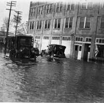 Image of N13582 - REMARKS:Corner of N. Jackson Street and Winchester Street during the flood on Feb. 20, 1927. Autos in high water in front of the Creason Building.  OBJECT DATE:Feb. 20, 1927
