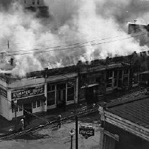 Image of N13906 - REMARKS:A fire on Cass St., Roseburg, Oregon, buildings on the north side of the street between Jackson and Rose Streets, June 24, 1943.  OBJECT DATE:June 24, 1943