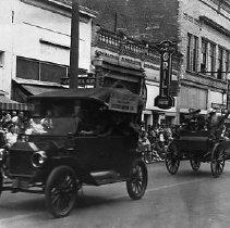 Image of N13910 - REMARKS:A rodeo parade on Jackson St., Roseburg, Oregon, November 11, 1946.  OBJECT DATE:November 11, 1946