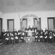 Image of N1395 - Masonic Lodge group, Roseburg, OR, 1885. Shows interior of lodge room with members. I.D. LtoR, back row: Conklin S. Caro; Joseph Cawlfield; N.T. Jewett; Free Johnson. Second row: Unidentified; Unidentified; Unidentified; Unidentified; Jamison John Brown; B. Vinson; Unidentified; Unidentified; Unidentified; Unidentified; Unidentified. Front row: Stolce; Howell; Mut Wilkins; Asher Marks; Dr. Burnell; Andy Jones; Ed Elliott; Al Deer.(Identification is copied from the back of the original - Some of the names I could't make out so I listed them as Unidentified).