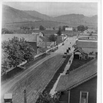 Image of N13958 - COUNT:2  REMARKS:The flag raising ceremonies at Yoncalla, Oregon, on Memorial Day, May 30, 1917. The view shows an elevated view of Main Street looking east from the I.O.O.F. Hall.  OBJECT DATE:May 30, 1917
