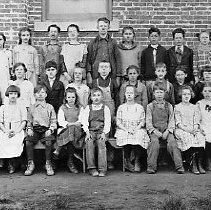 Image of N14198 - REMARKS:A Yoncalla, Oregon, school group, 1920, third and fourth grades. First row: Alice Hummel; Jack Sherman; Maxine Stearns; Haraly Cooper; _______; Dan Guard; Willeta Miller; Roscoe Cannon; Juanita Miller; Marie Toner; Lauenna Wilson. Second row: _________; ________; Elbert Faudray; Doris Mathis; ________; Alice Hummel; Stanley Rupprecht; Elmer Coons; Madeline McKaig (4th grade); Bernice Richards. Third row: Vance Fenton; _________; Helen Mathis; Jean Cowan; Naomi Daugherty; ________; Bertha Sutherlin; _________; Raphael Wise; _________; Lucille Christy.