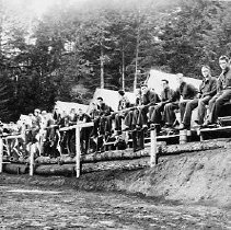 Image of N14222 - REMARKS:Civilian Conservation Corps., Camp Melrose, Company 759, 1933. Men lined up on fence with tents in view, Melrose, OR.