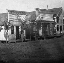Image of N14244 - REMARKS:Oakland, OR, ca 1868. William Moses' Oakland Meat Market at left, Central Hotel at right. This is old-town Oakland before it moved when the O& C RR came through.  OBJECT DATE:ca 1868