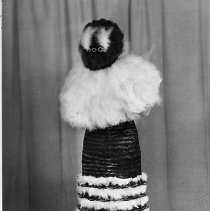 """Image of N14263 - REMARKS:Barbara Orr Ehrhart modeling a gown that she made from turkey feathers, called, """"Fine Feathers"""". View of back of dress, ca 1949. Roseburg, OR?  OBJECT DATE:ca 1949"""