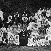 Image of N14396 - COUNT:2  REMARKS:Wilson family reunion, August, 1918, near Yoncalla. Descendants of W.H. Wilson and Hannah Dickenson Gillam Wilson; Mrs. Wilson shown in picture, in the front center in dark dress and ruffled hat (she is 85 years of age).  OBJECT DATE:August 1918