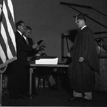 Image of N14453 - REMARKS:Roseburg High School graduation ceremony;, man receiving diploma, ID (L-R) unident.; Harry Jacoby; unident., May 28, 1957.