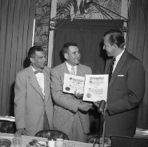 Image of N14508 - REMARKS:March of Dimes presentation to Del McKay at the Umpqua Hotel, April 23, 1956