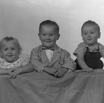 Image of N15041 - REMARKS:The Bob Scauce children. Two boys and a girl. Portrait; ca 1950s.  OBJECT DATE:ca 1950s