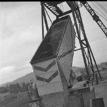 Image of N15375 - REMARKS:Chip truck being emptied, close-up view. Douglas County, OR; ca 1950s.  OBJECT DATE:ca 1950s