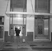 Image of N15486 - REMARKS:Douglas County State Bank, 102 N. Jackson, Roseburg, OR. Exterior view showing walk-up window with three customers. Ca late 1950s or early 1960s.