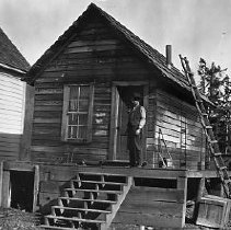 Image of N15828 - REMARKS:Small board shack, built high off the ground, with front steps, stovepipe on roof. Glendale, OR, ca 1910.