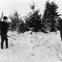 Image of N15874 - COUNT:2  REMARKS:Gus and Hazel Peret in winter setting, Hazel with camping gear and Gus taking photograph. Yoncalla, OR; ca 1930s. Peret Collection.  OBJECT DATE:ca 1930s
