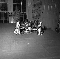 Image of N16267 - REMARKS:Christmas decorations at the Motschenbacher home, 1971. Two views, one showing figurines and candles, the other a framed scene.