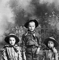 Image of N16598 - PHOTOGRAPHER:Clark StudioüRoseburg, OR  REMARKS:Three boys dressed up like cowboys, ca 1911. Floyd Church; Clarence Church and Ralph Church at right. Roseburg, OR.  OBJECT DATE:ca 1911