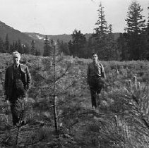Image of N16688 - REMARKS:Umpuqa National Forest ranger Harold Bowerman on the right with an unidentifies man on the left.