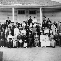 Image of N167 - COUNT:2  REMARKS:2 negs.; Wilbur Academy Reunion group photos. ca. 1915. Judge J.W. Hamilton is sixth from left in middle row.  OBJECT DATE:ca. 1915