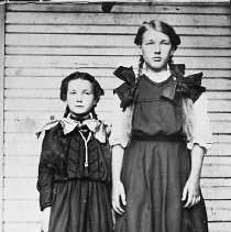 Image of N16835 - REMARKS:Frankie Louise Henry and sister Hazel Vivian Henry, ca 1907. Frankie is the younger sister at left. Postcard view. On the back it is written to Echo Kruse in Roseburg, OR, from Hazel and Frankie.  OBJECT DATE:ca 1907