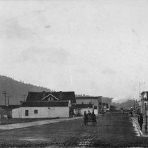 Image of N16873 - COUNT:2  REMARKS:Street scene of Sutherlin, OR, January 1913. View looking west.  OBJECT DATE:January 1913