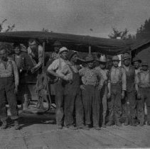 Image of N1720 - REMARKS:Logging crew & jitney, Drain. Dick Sanders, driver. Crew includes: Marion Ryan, Dennis Bodle, William Miller, Sr., George Montgomery, Bill Mattoon, Whit Kirtley, Chub Harlan and Oscar Mattoon. ca. 1920. DCM orig.