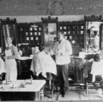 Image of N1735 - REMARKS:Barber shop interior, Roseburg 1897. Fred Jones, far right. (Son of Mark and Francis McKinney Jones)