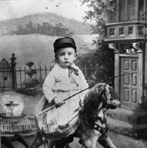 Image of N2909 - REMARKS:Small boy on rocking horse. Price family, New York ?