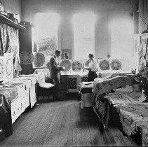 Image of N3173 - REMARKS:Interior view of H.D. Graves' Art Emporium, a needlecraft and photo supply store located on Cass Street in Roseburg, OR. Copied from a DCM H.D. Graves photo album.