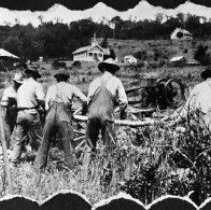 """Image of N3230 - REMARKS:Cutting wood, gas engine powered buzz saw. Picture taken on the Holmquist farm; Elgarose School is in the background. Carl R. [""""Dick""""] Holmquist is second from left in photograph."""