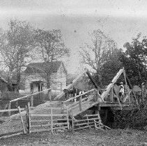 Image of N3424 - REMARKS:W.A. Pearce home, Deer Creek, ca. 1901. W.A. Pearce, left foreground; Mrs. W.A. Pearce and baby, Thelma, beyond gate; Tom Strader and Pearl Pearce, on bridge.  OBJECT DATE:ca. 1901