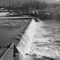 Image of N35.186 - REMARKS:Various shots of heavy ice on the dam, floating in the water, and on the bridge.  OBJECT DATE:December 11, 1972