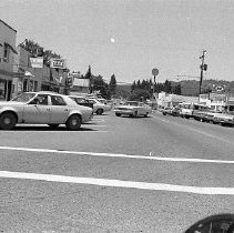 Image of N35.236 - REMARKS:Several views of Canyonville, OR, showing antique shops as well as horses grazing in a pasture, ca. 1973.  OBJECT DATE:June 19, 1973