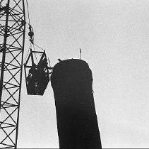 Image of N35.493 - REMARKS:Demolishing the smokestack at the Veteran's Hospital. Pictures of a large crane removing parts.  OBJECT DATE:October 18, 1976