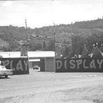 Image of N35.57 - REMARKS:Front gate at Douglas County Fairgrounds, Roseburg, OR.  OBJECT DATE:August 9, 1971