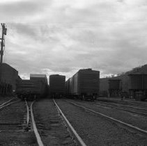 Image of N3733 - REMARKS:S.P. railroad yards, Roseburg, looking south from Mosher Street. 1956. Shows water and oil tanks and part of turntables.