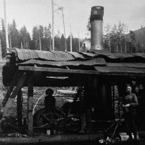 "Image of N4229 - REMARKS:Steam logging donkey & crew, ""In Fisher Brothers camp""."