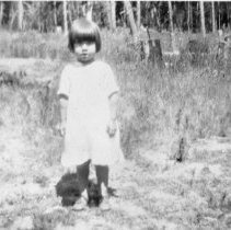 Image of N4735 - REMARKS:Margaret Dumont as a child standing in a field.