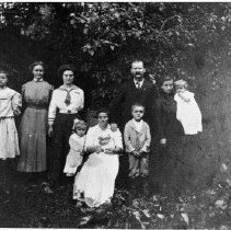 Image of N4864 - REMARKS:DeGnath family, Elkton, Or. ca. 1911. Rear, left to right: Theresa, Bertha, Augusta, August (father) Louise holding Lena. Front, left to right: Rose, Bertha (mother) holding Elwin, August. Violet wasn't born yet.  OBJECT DATE:ca. 1911
