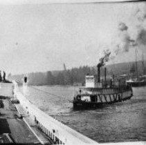 Image of N5466 - REMARKS:Sternwheeler HENDERSON pulling hull of the PAULINE out of the mud; Str. HENDERSON also towed the vessel to Astoria for finishing.