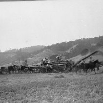 Image of N56 - Horsepower threshers. Phipps (Rice) Ranch, Dillard. (Ford's Mill Site) In view is: Ed Smith, Abner Rice, Alton Rice, & Human Huntley