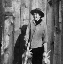 Image of N5868 - REMARKS:Flossie McMillen Tolles with double-barreled shotgun and bag of rabbits. Douglas County.