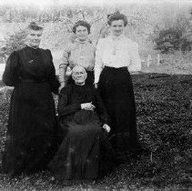 Image of N6235 - REMARKS:A group of women. Standing (left to right): Letty Kamp; Mrs. Jeff Cott; Mrs. Nelly Sturges. Seated is their mother, Mrs. Croton.