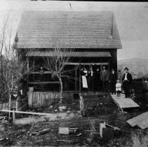 Image of N6677 - REMARKS:Homestead in the Blue Mountains, eastern Oregon. View of cabin including women and children and the four Beymer men, Charles, Frank, Fred and Thomas.