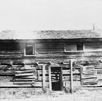 Image of N7963 - REMARKS:A view of the original Riddle hewn log cabin, a story-and-a-half structure on the Riddle's Glenbrook Donation Land Claim.