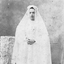 Image of Celia Parazoo, age 16 years. Wearing confirmation dress.