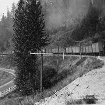 Image of N8361 - REMARKS:Pacific Highway looking south down Pass Creek near Divide, Or. Southern Pacific north bound extra train drawn by engine 2549 ? approaching at right.
