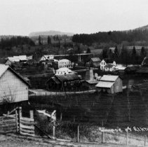 """Image of N8730 - REMARKS:Elkton, Or. View shows orchard in foreground, house, barns, etc. and Mary Beckley Bridge over Umpqua River in middle background.  INSCRIPTION:""""Glimpse of Elkton, Or."""""""